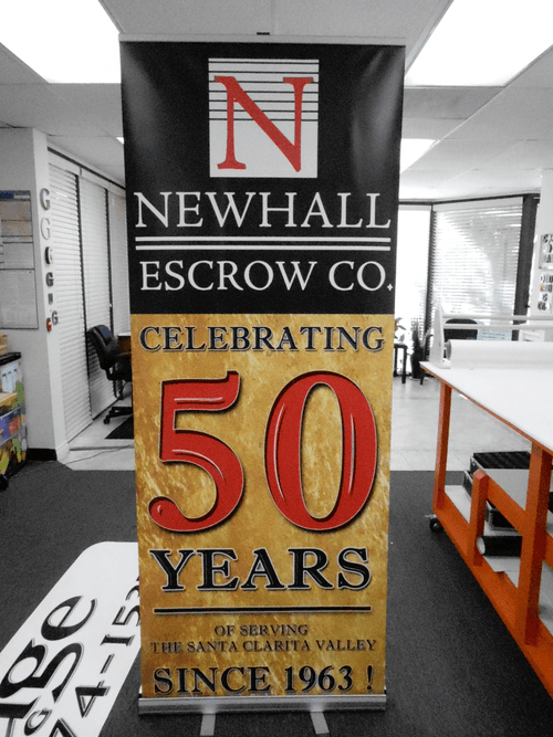 newhall escrow retractable banner